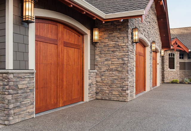 Beautiful custom home featuring cape cod uintah ledgestone for Wood veneer garage doors