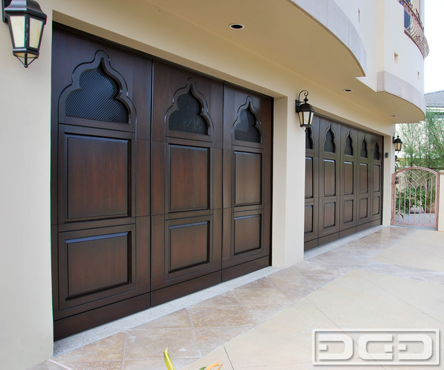 Borrowed indian architectural details on a custom wood for Architectural garage doors