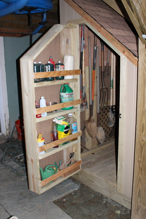 small storage area concealed under a deck