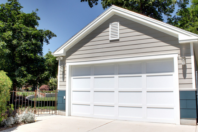 Contemporary clapboard two car garage with man door 2 car garage doors