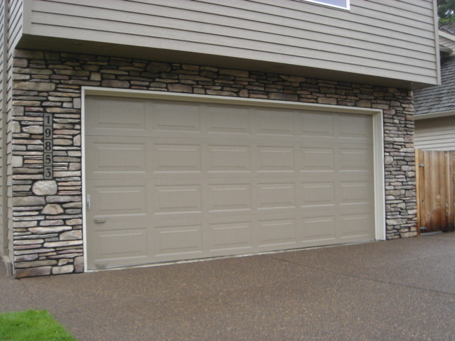 Cultured stone veneer exterior traditional shed for Wood veneer garage doors