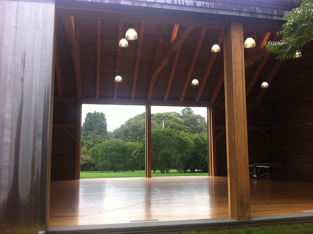 Custom barn sliding doors indoor basketball court for Indoor basketball court installation