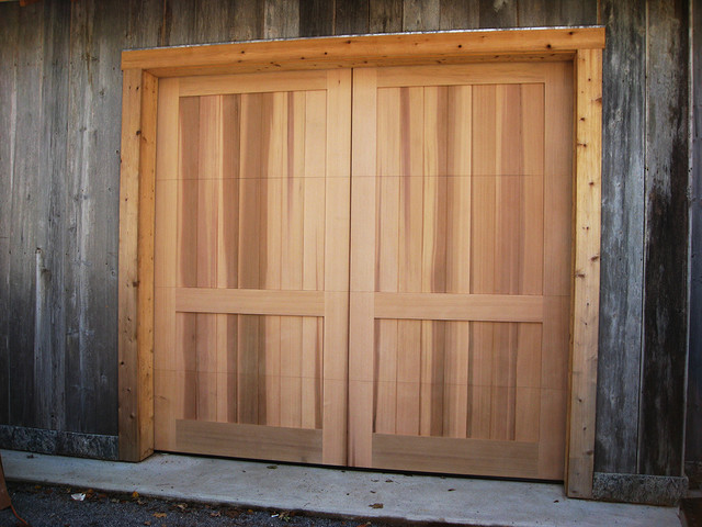 Custom wood garage doors farmhouse garage and shed for Farmhouse garage doors