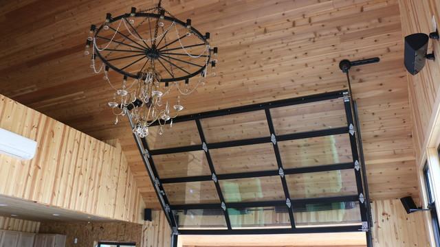 Entertainment Room With Overhead Glass Garage Door