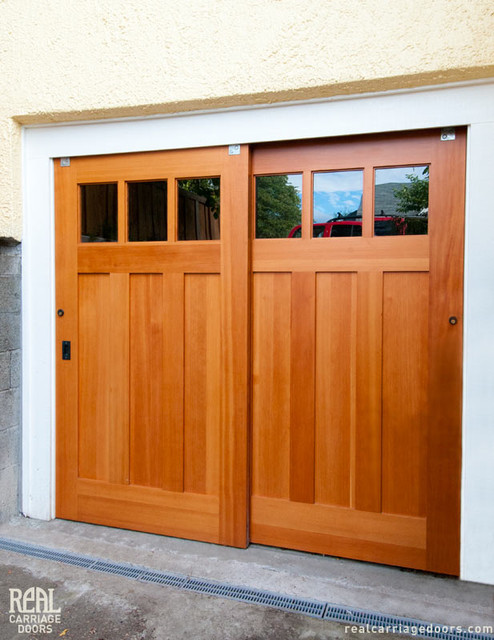 Exterior bypassing sliding doors opens up utility space for Sliding door front door