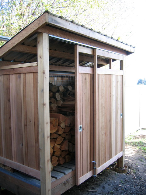 Firewood shed built with reclaimed materials Modern Shed