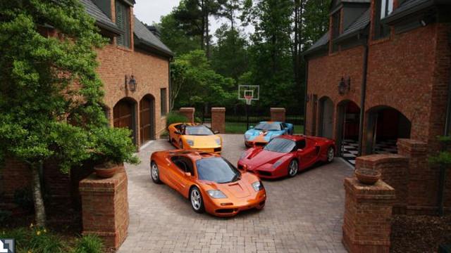 Garage courtyard filled with exotics mediterranean for What is a courtyard garage