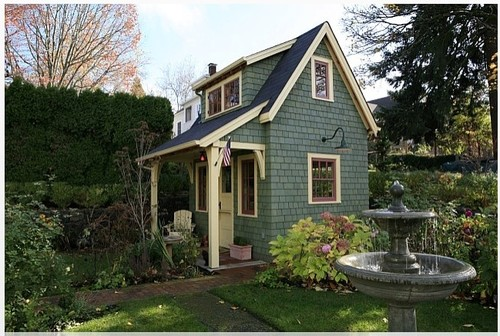 A joyful cottage living large in small spaces seven for Traditional garden buildings