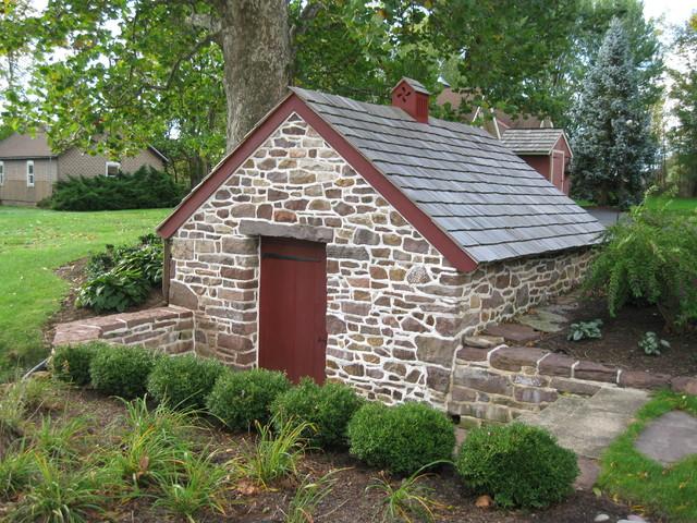 Historic spring house restoration traditional garage for Stone garden shed designs