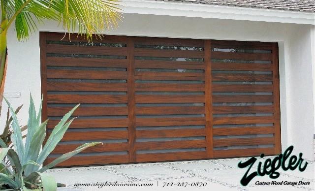 Modern garage door modern garage and shed orange for Modern shed prices
