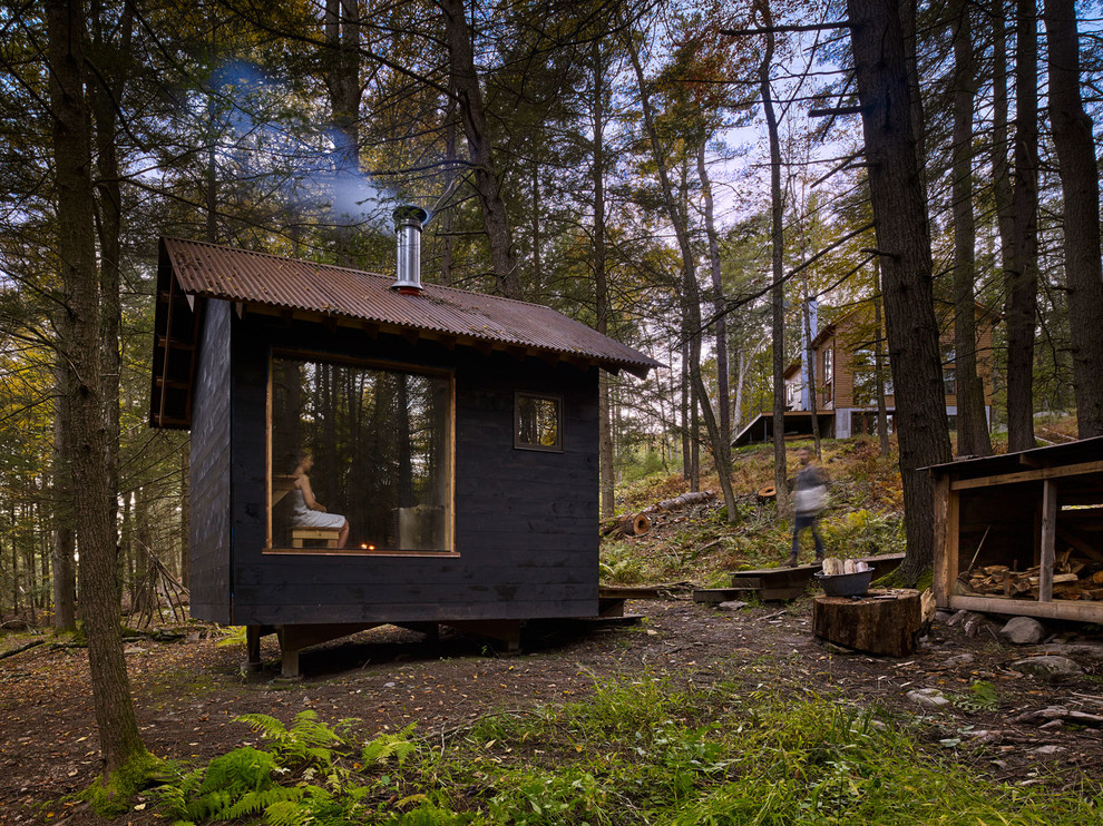 Example of a mountain style detached shed design in New York