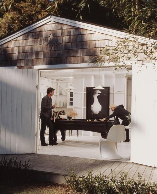 Garage door opens to reveal pool table