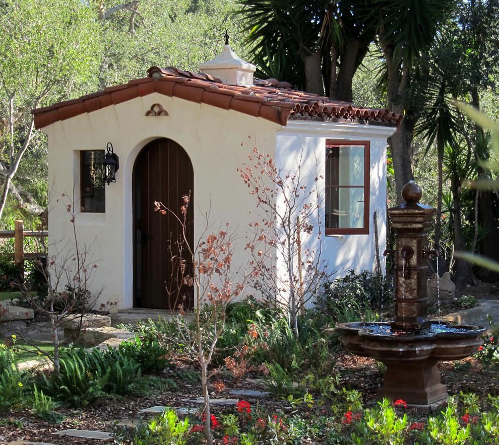 Garden shed - small mediterranean detached garden shed idea in Santa Barbara