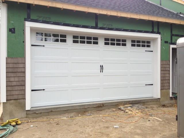 Steel carriage house garage doors modern garage and for Overhead door for shed