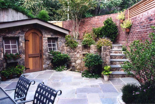 Stone shed and garage with flagstone patio rustic for Stone garden shed designs