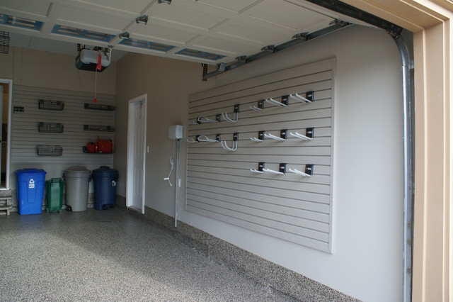 Tons o' slatwall - Modern - Garage And Shed - other metro - by CLOSET ENVY INC.