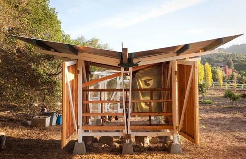 This is one of the most unique coops we've seen, with a modular design that opens up on the sides for full access and fresh air. The V-shaped roof channels water away from the birds.
