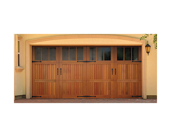 Wood Doors - The Wayne Dalton 7100 models combine the classic swing-open appearance and detailing of carriage house wood doors with the convenience of standard sectional garage doors.