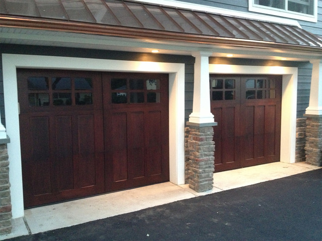 Wooden garage doors contemporary garage and shed for Modern house garage doors