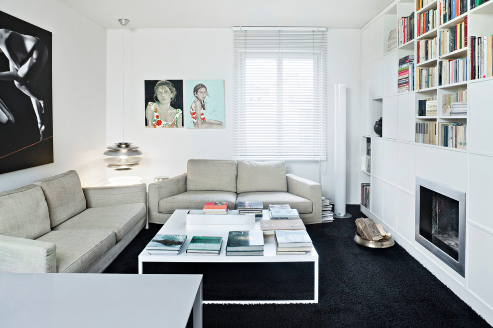 Example of a small trendy enclosed black floor and carpeted living room library design in Milan with white walls, a standard fireplace, a metal fireplace and no tv