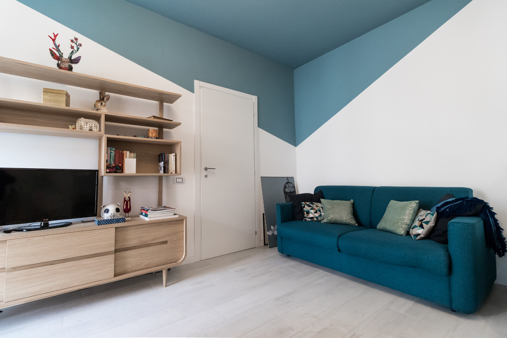 Example of a danish enclosed light wood floor and beige floor family room design in Milan with blue walls and a tv stand
