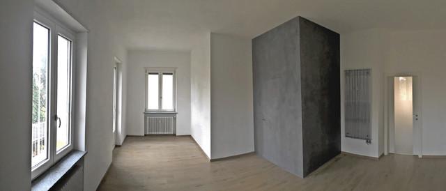 Ispirazione per un soggiorno minimal aperto con pavimento in gres porcellanato e pareti bianche
