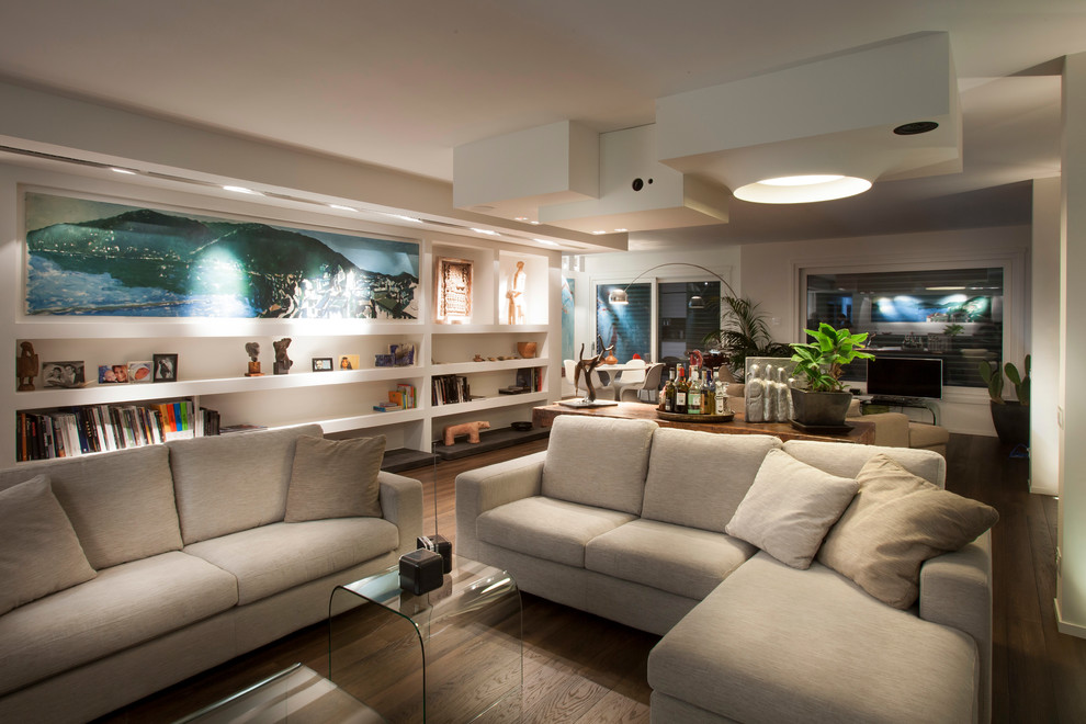 Large trendy open concept dark wood floor living room photo in Milan with white walls and a tv stand