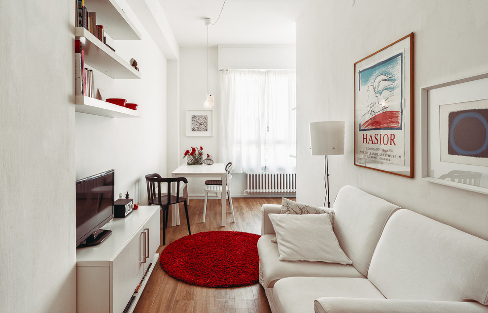 Inspiration for a small modern open concept medium tone wood floor living room remodel in Other with white walls and a tv stand