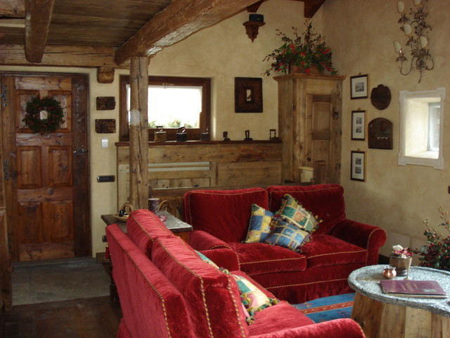 Edificio in stile rustico a la thuile ao in montagna for Casa in stile ranch rialzato