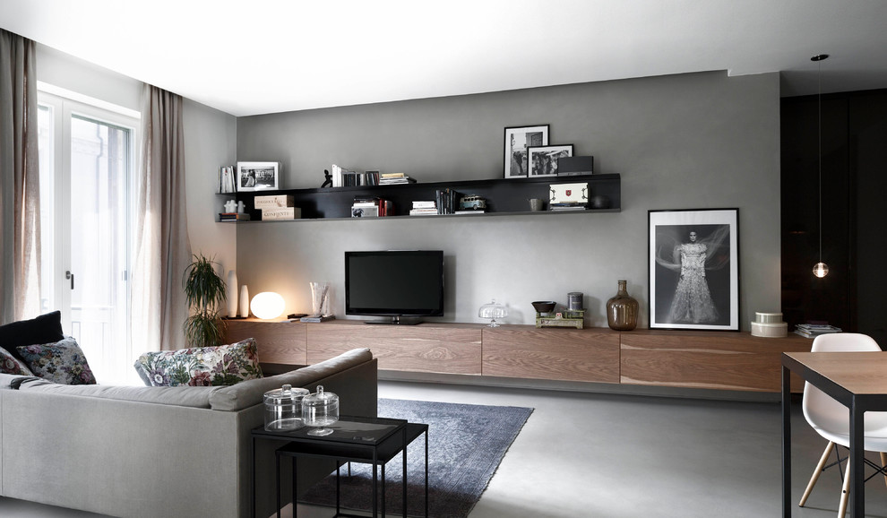 Example of a mid-sized trendy open concept living room design in Milan