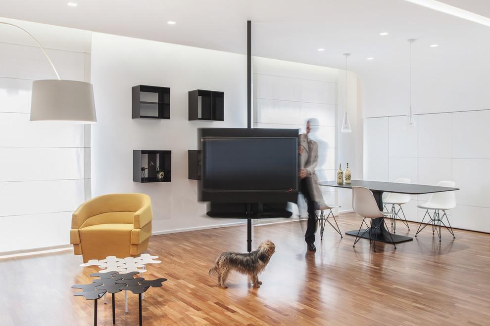 Modelo de sala de estar abierta, escandinava, con paredes blancas y suelo de madera en tonos medios