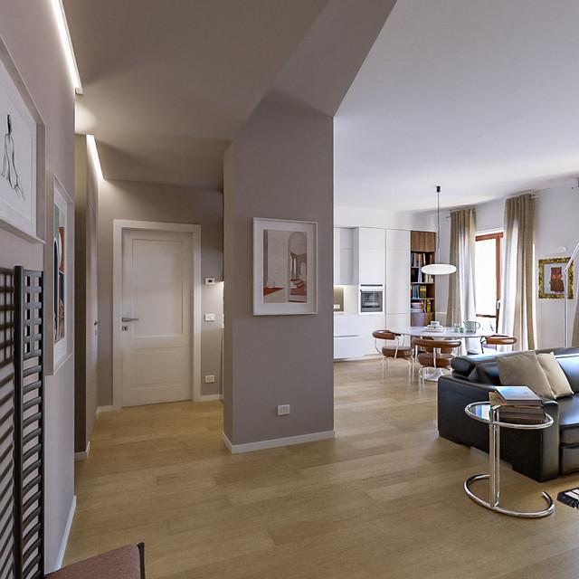 Esempio di un soggiorno contemporaneo di medie dimensioni e aperto con pareti beige, parquet chiaro e TV a parete