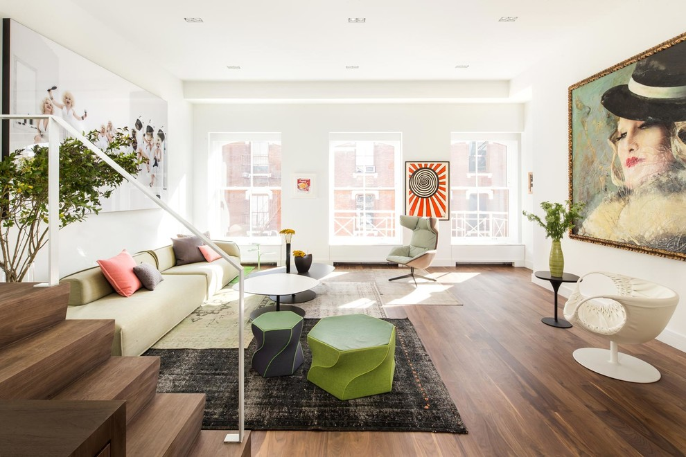 Trendy formal medium tone wood floor and brown floor living room photo in New York with white walls, no fireplace and no tv