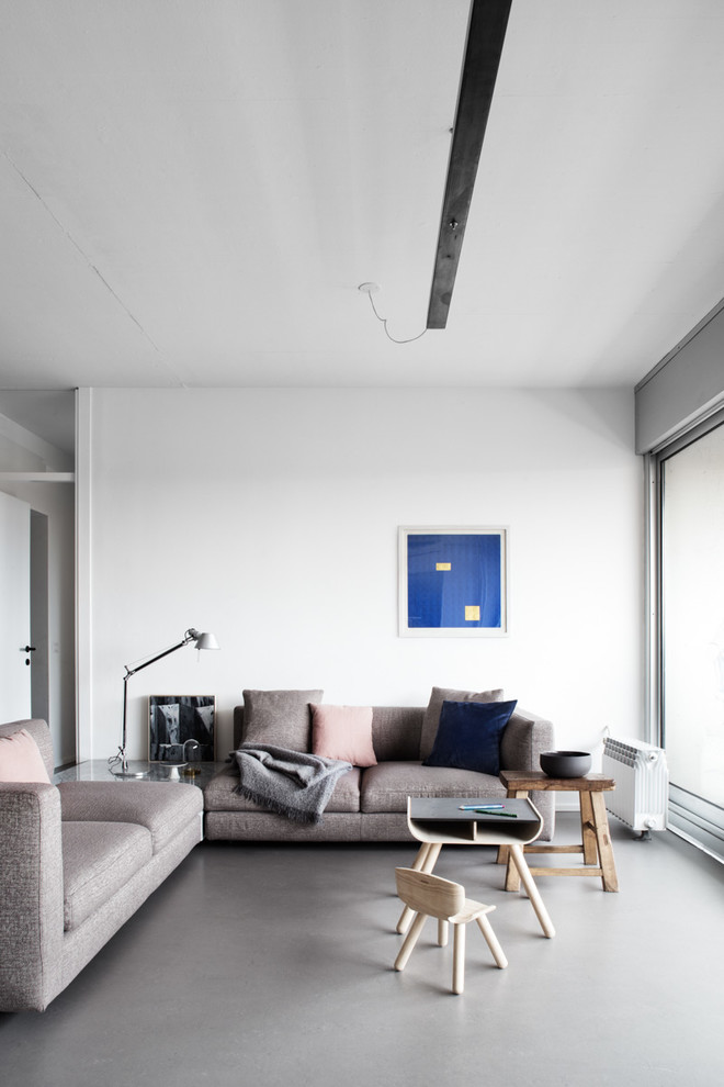 Mid-sized trendy open concept concrete floor and gray floor living room photo in Milan with white walls