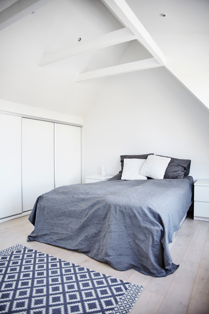 Large danish master light wood floor bedroom photo in Other with white walls and no fireplace