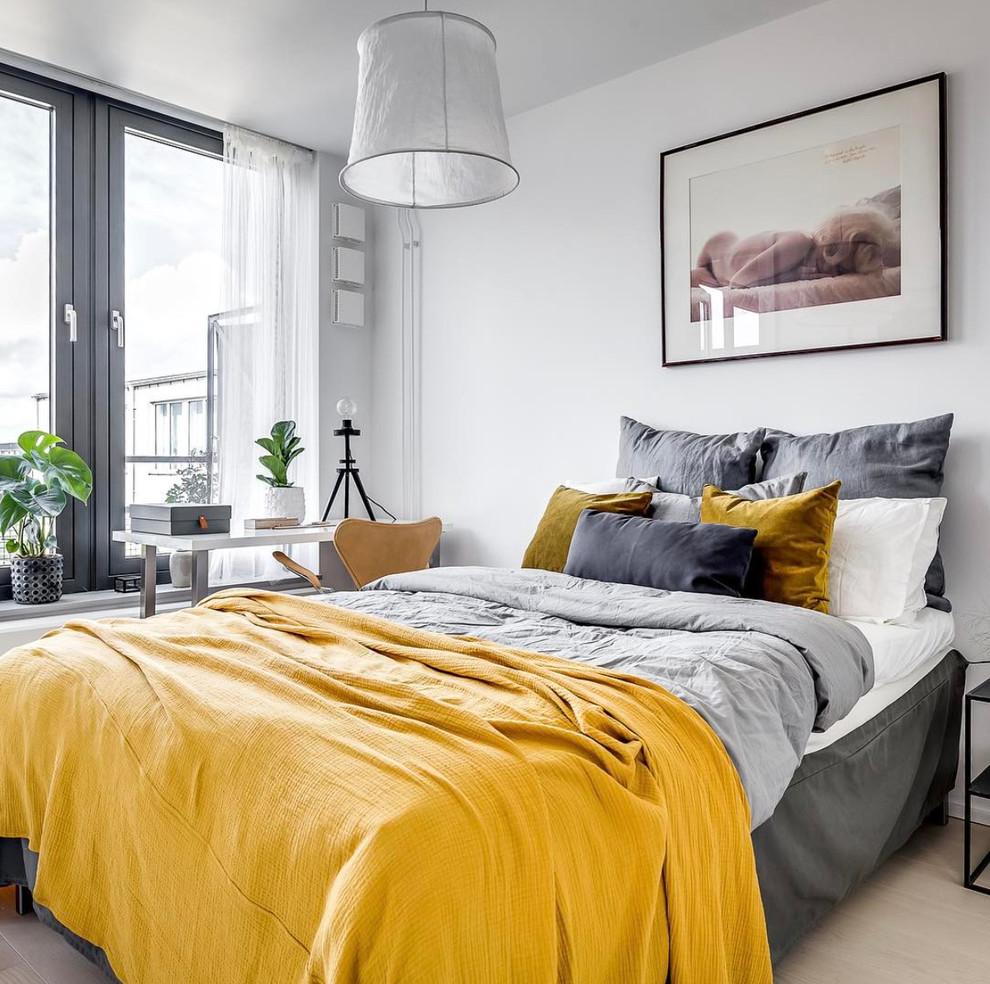 Bedroom - small scandinavian master light wood floor and beige floor bedroom idea in Stockholm with white walls and no fireplace