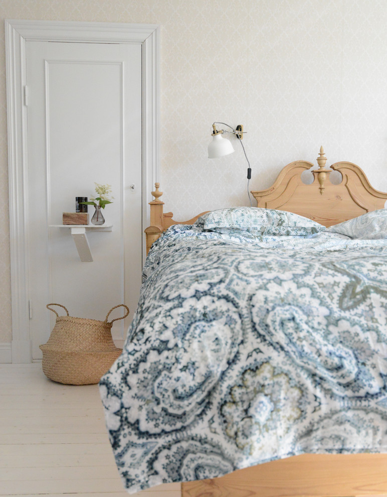 Inspiration for a large cottage master painted wood floor bedroom remodel in Gothenburg with beige walls and no fireplace