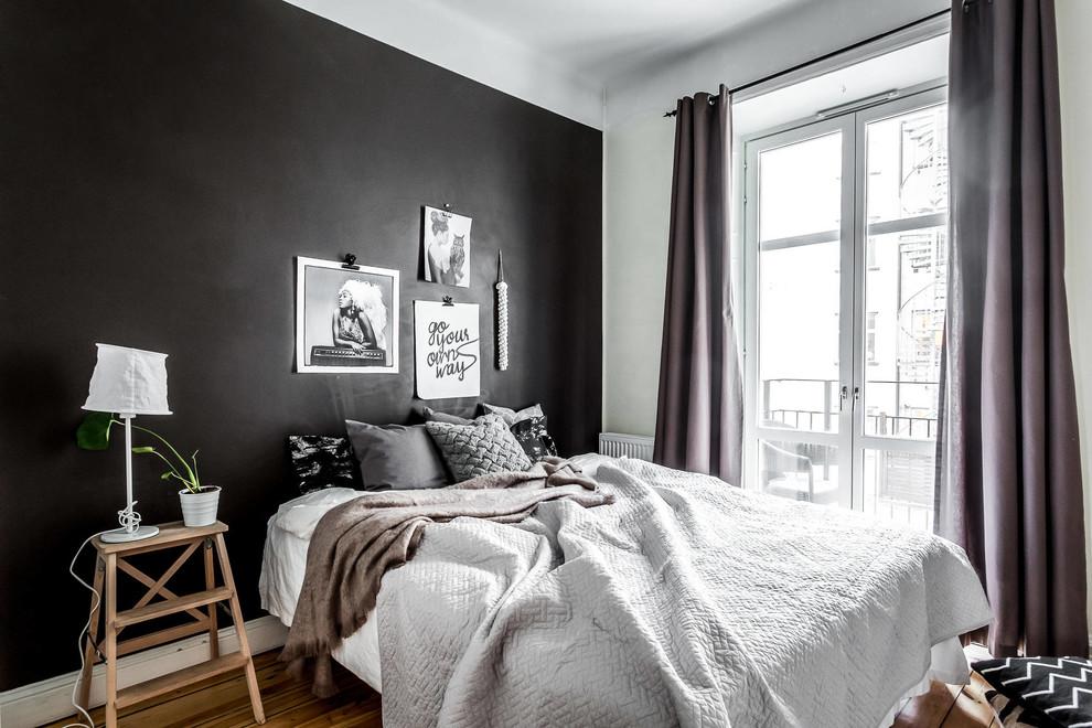 Mid-sized danish master dark wood floor bedroom photo in Stockholm with black walls