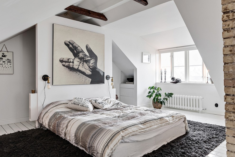 Inspiration for a mid-sized scandinavian master painted wood floor and white floor bedroom remodel in Malmo with white walls and no fireplace