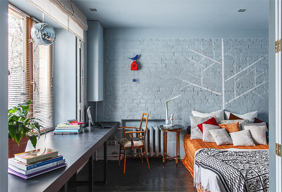 Example of a large eclectic master black floor bedroom design in Moscow with blue walls
