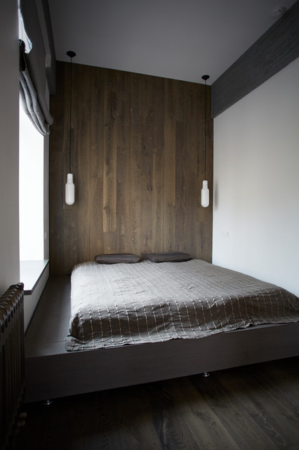 Minimalist master dark wood floor and gray floor bedroom photo in Moscow with white walls