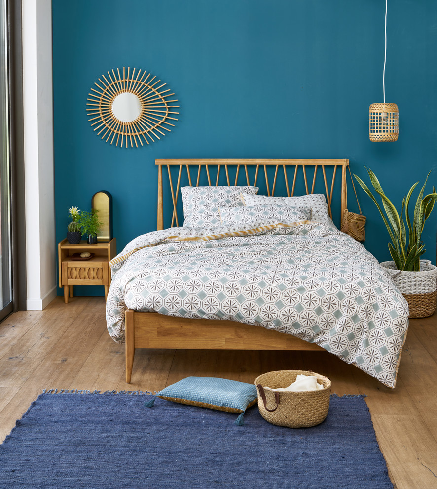 Bedroom - contemporary master medium tone wood floor bedroom idea in Moscow with blue walls and no fireplace