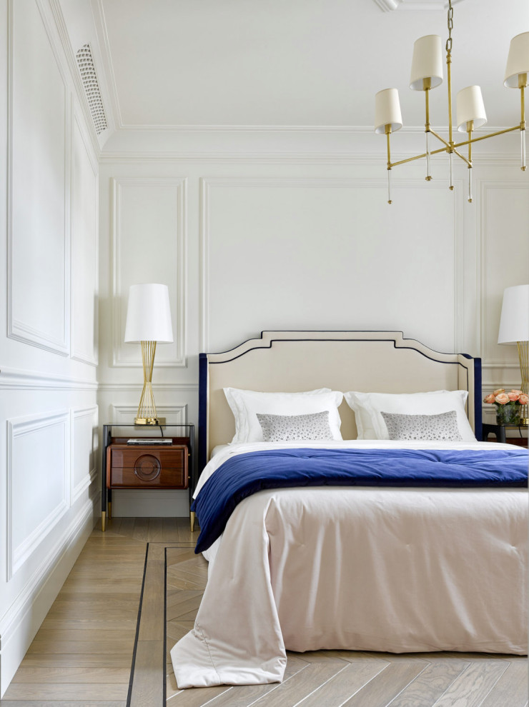 Example of a transitional master light wood floor and wainscoting bedroom design in Moscow with white walls