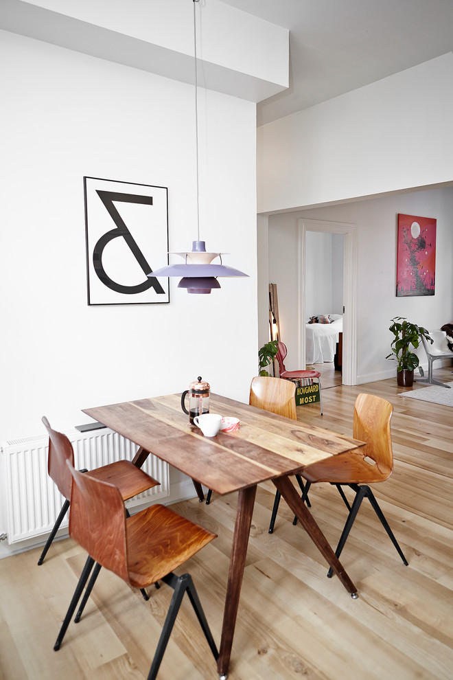 Photo of a mid-sized scandinavian separate dining room in Aarhus with white walls, light hardwood floors and no fireplace.
