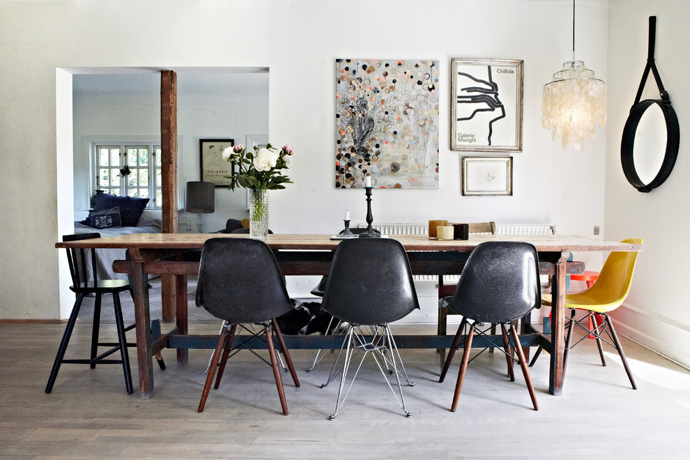 Mid-sized trendy light wood floor and gray floor enclosed dining room photo in Other with white walls and no fireplace