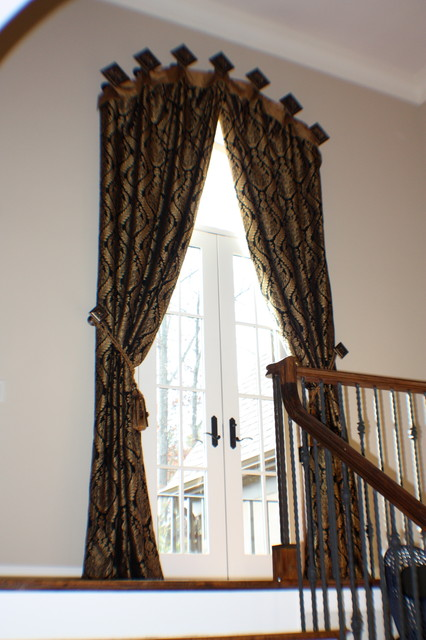 2 Story Arch Cuffed Drapery Panel On Stairway Landing