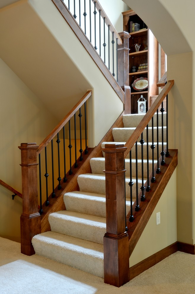 Example of an arts and crafts staircase design in Milwaukee
