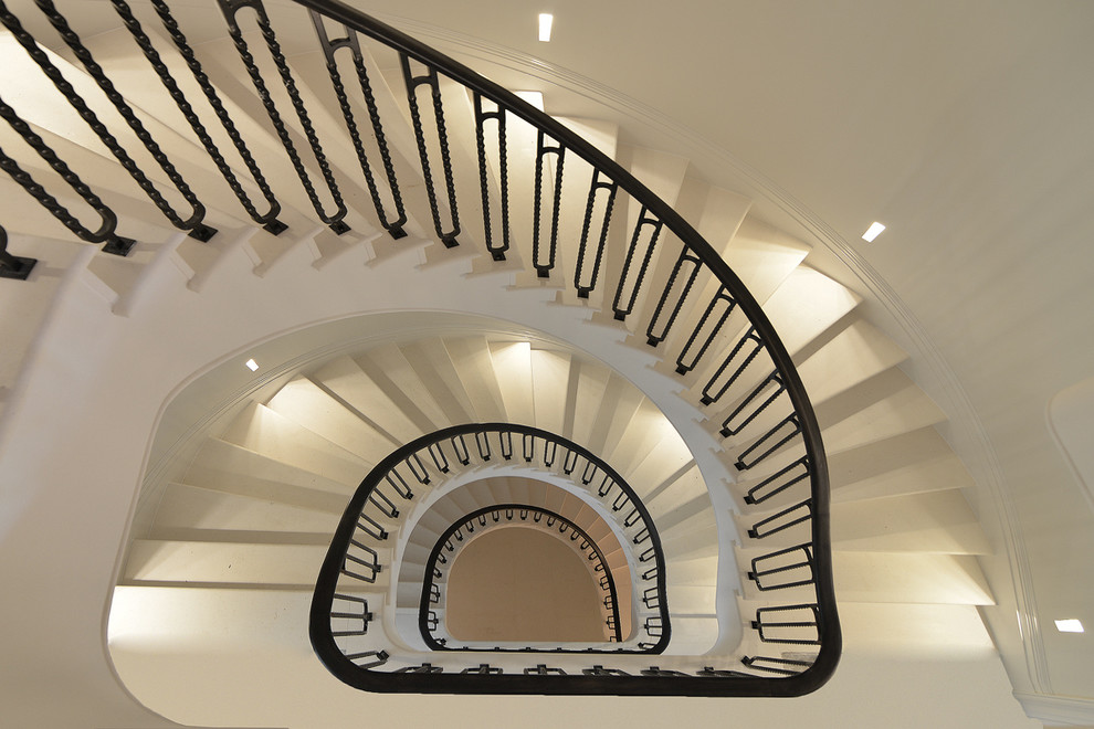 Example of a large trendy spiral staircase design in London