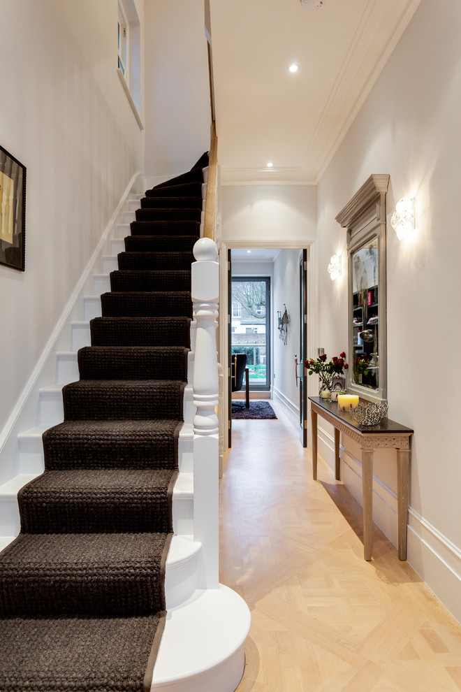Small ornate wooden l-shaped staircase photo in London with wooden risers