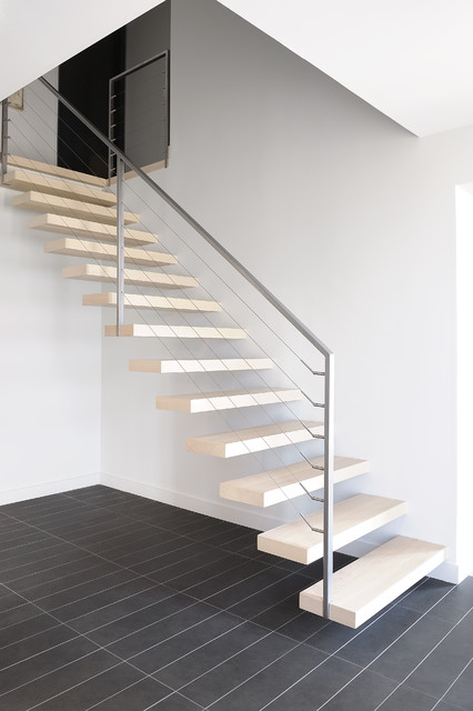 Mid-sized trendy wooden floating open and cable railing staircase photo in Montreal